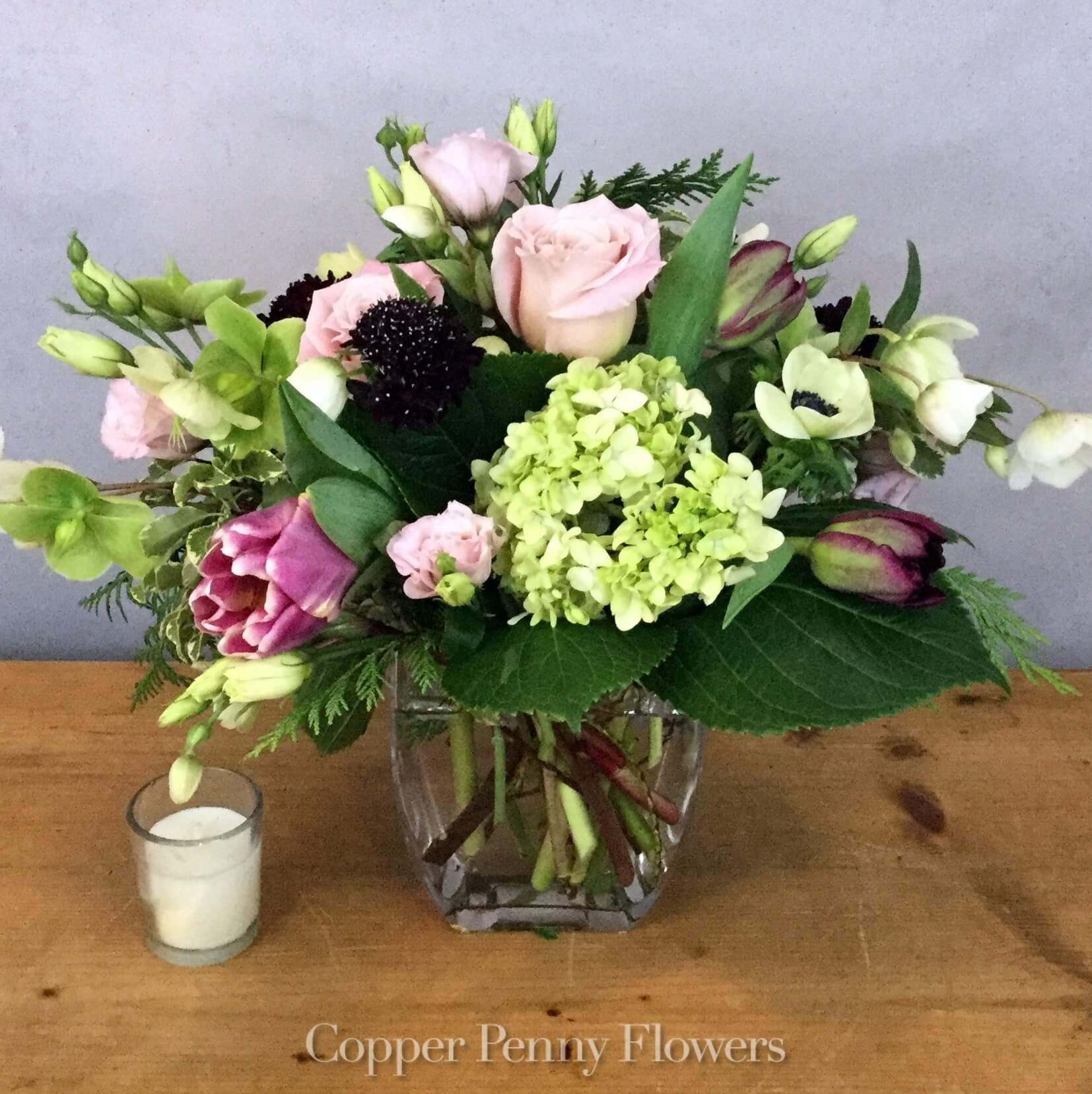 Mint Tulip features hydrangea, tulips, and roses, in pastels and deeper tones
