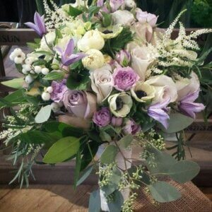 bridal bouquet in whites and purples