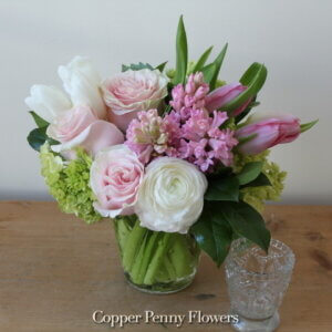 Sweet Spring flower arrangement from Copper Penny Flowers features roses and tulips in pinks and whites
