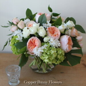 Peach Veranda Premium Flower Arrangement from Copper Penny Flowers features garden roses, spray roses, and green hydrangea
