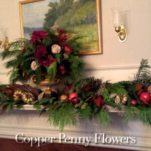 holiday mantel floral designs featuring evergreens, roses, and natural and metallic accents