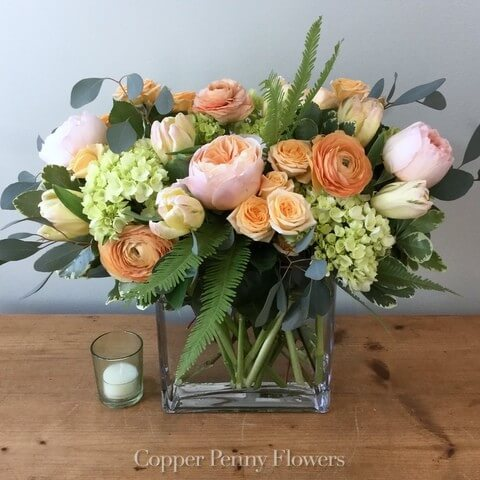 Peachy Keen is lush flower arrangement featuring peach and green flowers