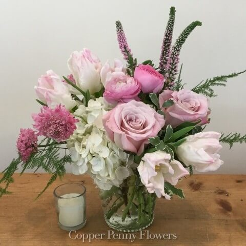 Dancing In Pink flower arrangement features white hydrangea with pink tulips and ranunculus
