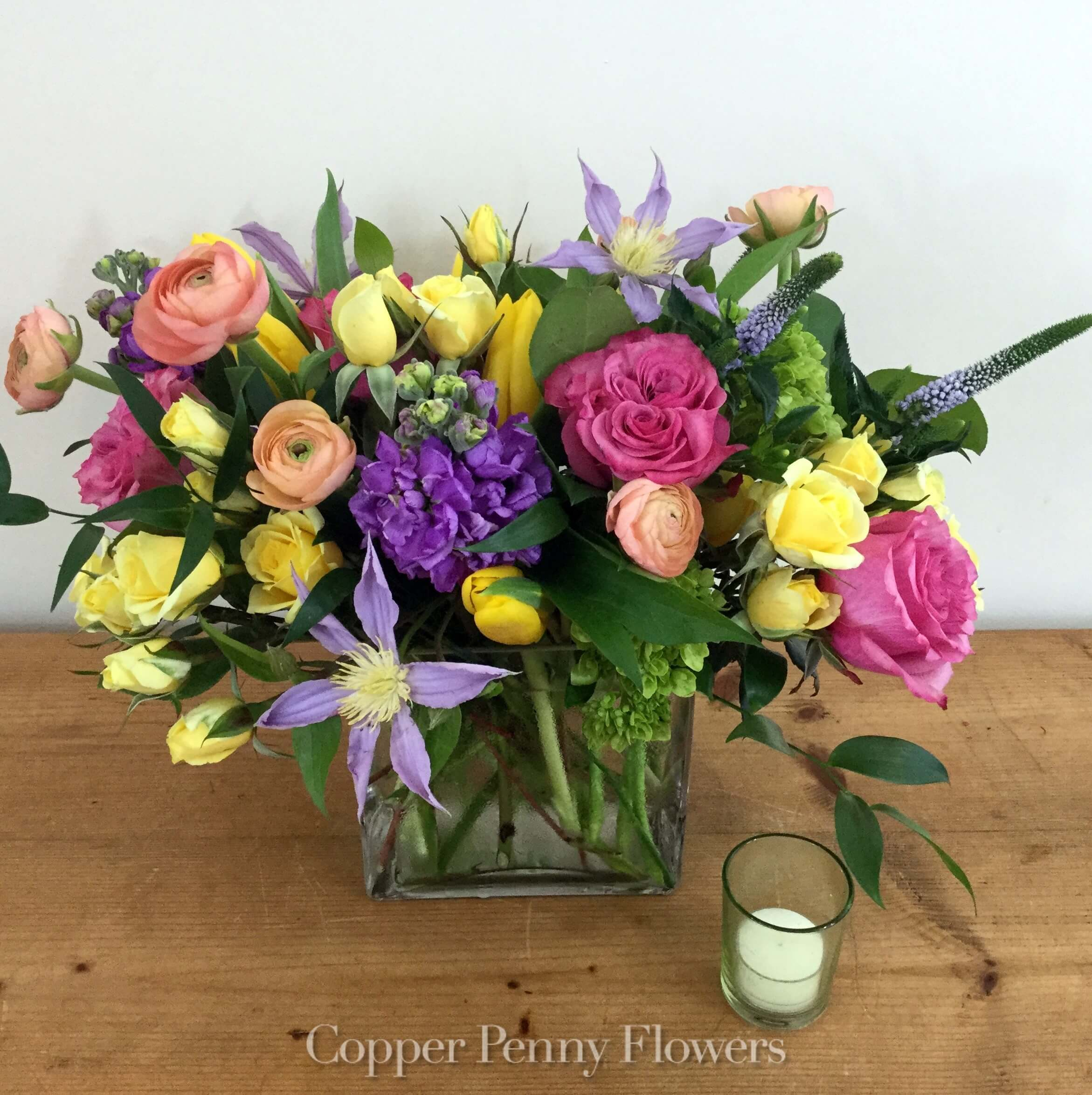 Butterfly Happy flowers arrangement is a mixed spring flowers in a glass rectangle