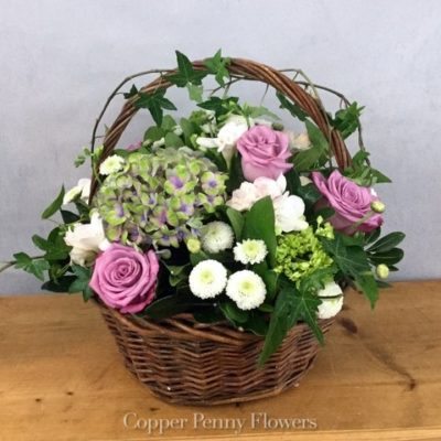 A Full Life Features Hydrangea And Roses In A Wicker Basket