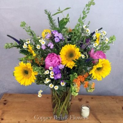 Fields of New England features local grown seasonal blooms in a glass vase