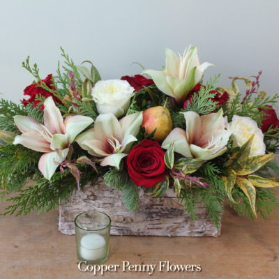 Season to Smile features amaryllis and roses in a keepsake birch box