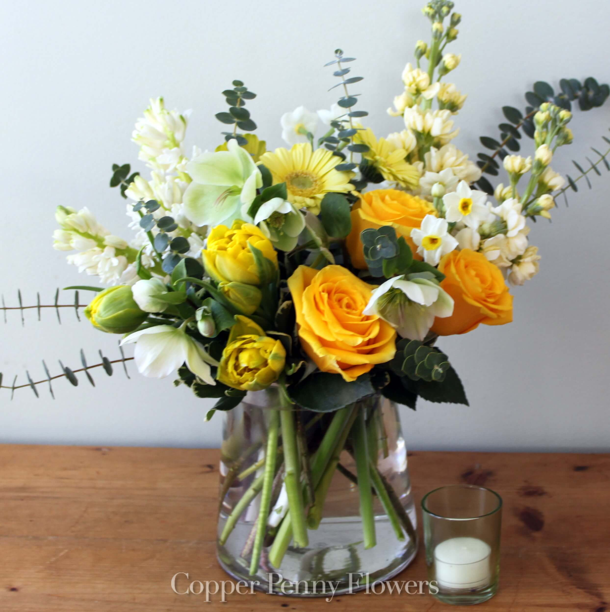 Pure Honey flower arrangement features roses, tulips, and stock in shades of yellow, cream, and white