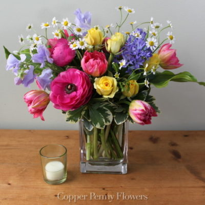 Come Spring bright mixed flower arrangement with tulips and hyacinth