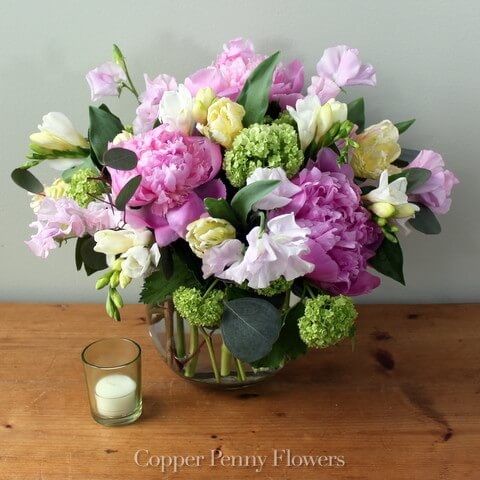 Happiness features peonies and viburnum and sweet peas in a glass bowl