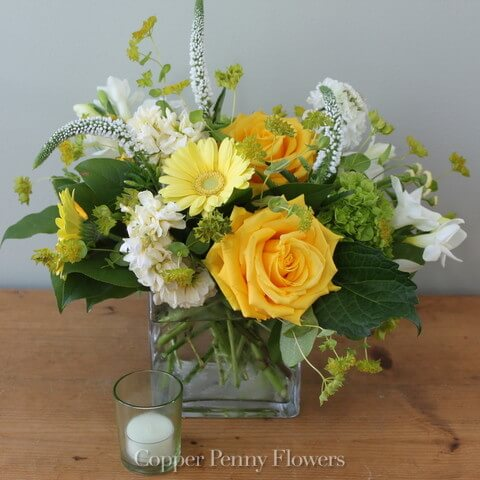 Sunkissed is a garden-inspired flower arrangement in yellows and whites