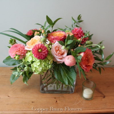Sweet Apricot flower arrangement features dahlias, roses, and hydrangea