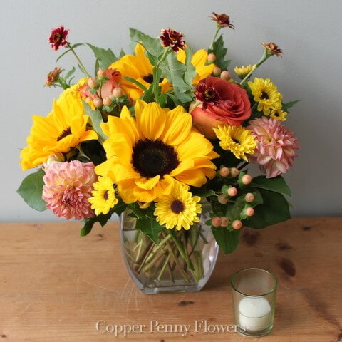 Golden Afternoon flower arrangement features sunflowers, dahlias, and mums in autumn hues