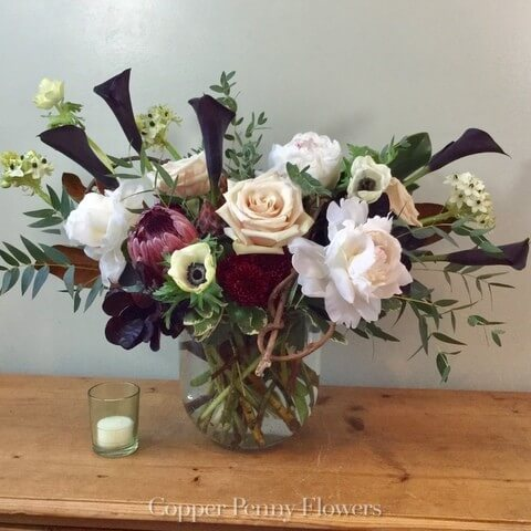 center State flower arrangement features peonies, roses, and calla lilies