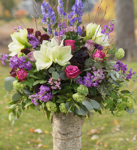 purple wedding arrangement in birch by copper penny flowers