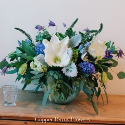 Cloud 9 Flower Arrangement Featuring White Amaryllis, Purple Hycinth, And Lemon Tulips