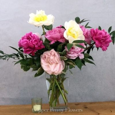 Peonies Forever is an all peony arrangement in a glass vase