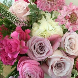 Beth's Tranquilitly is a hand-held bouquet of premium flowers in shades of pink