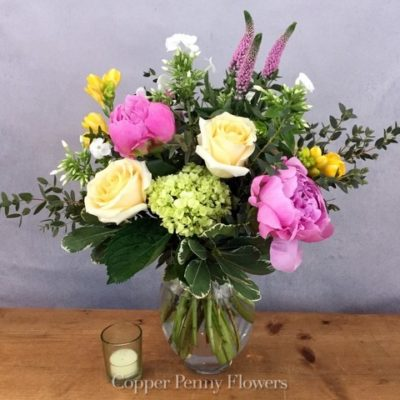 New Day flower arrangement features green hydrangea, pink peonies, and roses