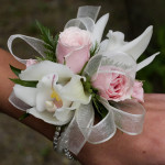 cymbidium and pink rose corsage