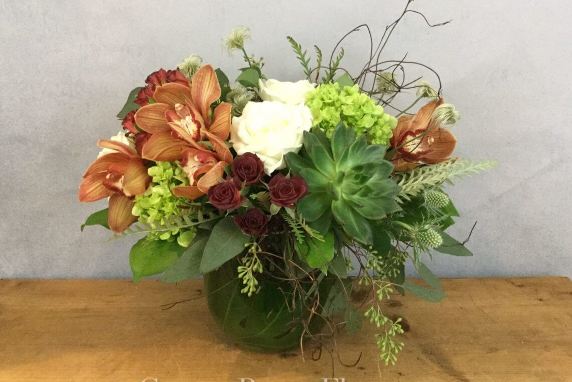 Alabaster and Vine features alabaster garden roses with orchids, hydrangea, and succulents