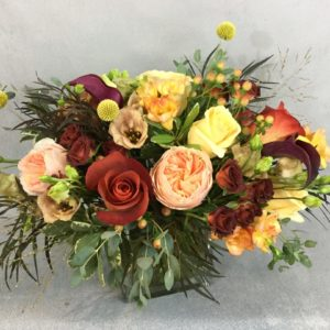 Autumn Glow features roses in copper and cream tones