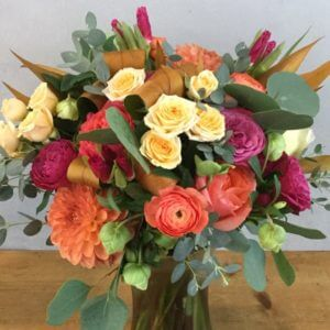 Breath of Autumn is a blend of roses and ranunculus and mums in autumn hues
