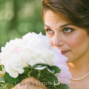 bride holding floral boquet in Stow MA wedding