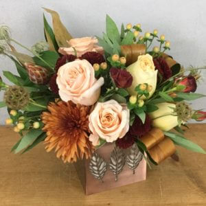 Falling Leaves is roses and mums with autumn accents in a decorative copper cube