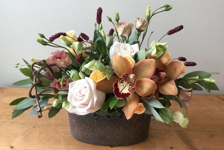 In A Mocha Mood is roses and orchids in autumn colors