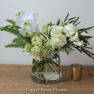 Paradise Is A Contemporary White Arrangement Featuring Orchids
