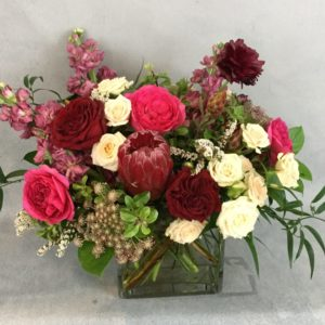 Ruby Sky features premium flowers in burgandy and cream tones