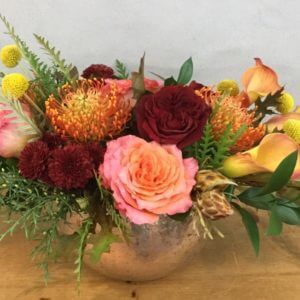 Siren's Call is a mix of roses and calla lilies with accents in fall colors