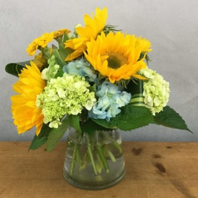 Sun and Sky features sunflowers and hydrangea